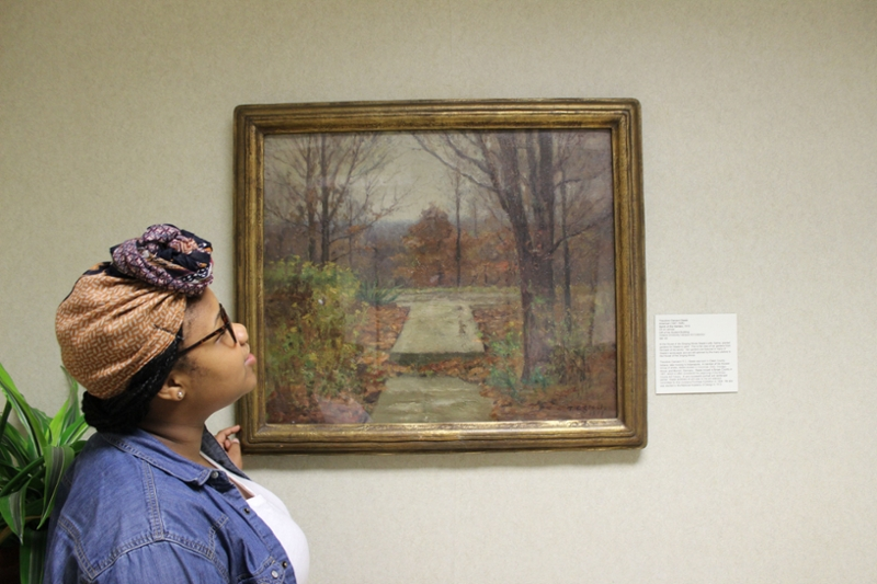 Student looking at art.