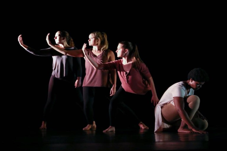Four student dancers performing.